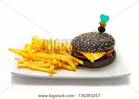 cheeseburger black batter with fries on a white plate