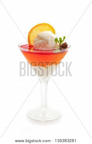 dessert from one ball of ice cream and fruit jelly decorated with lemon