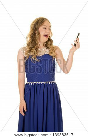 a woman with down syndrome looking at her phone laughing.