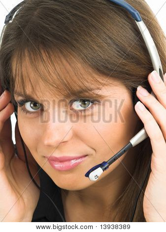Beautiful smiling woman with a headset - customer support style (See more photos of this model in my portfolio.)