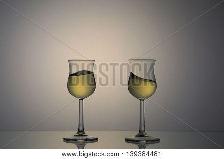 Backlit portrait of tasting glasses with marc
