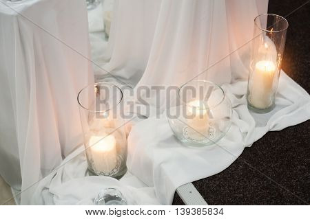 decorations and candles on a wedding table.