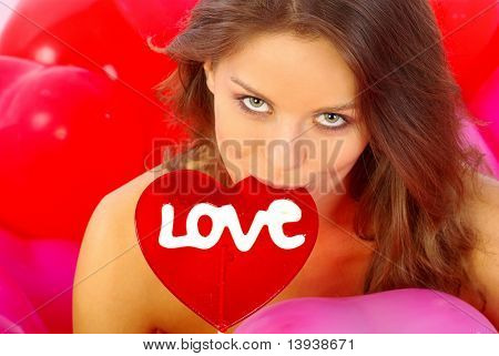 beautiful girl with red heart  isolated on white