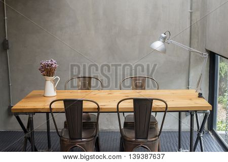 Modern desks with cement wall background, loft style