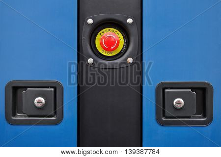 Button emergency power-off and fragments of blue panels with locks