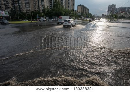 Saint-Petersburg Russia - June 16 2016: City highway surface is flooded with water. View of urban residential area.