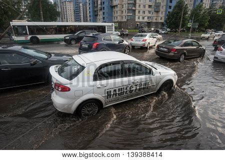 Saint-Petersburg Russia - June 16 2016: Aerial view of city roads flooded with water after torrential rain. Cars go slowly in traffic.