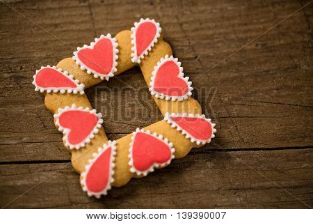 Valentine cookie on wood background, holiday concept