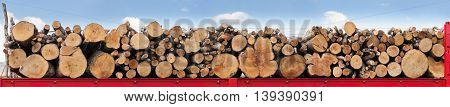 Tree trunks stacked in a row on a red truck ready to be transported. Horizontal four images side by side light blue background of sky and clouds.