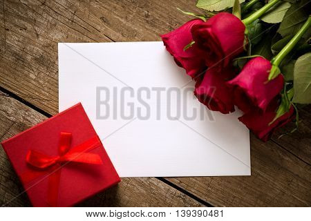 Gift Roses And Blank Paper For Valentine Day