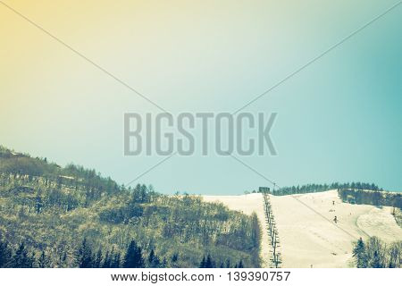 Mountain with ski ( Filtered image processed vintage effect. )