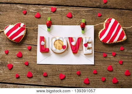 Valentine cookies and small red hearts, holiday concept