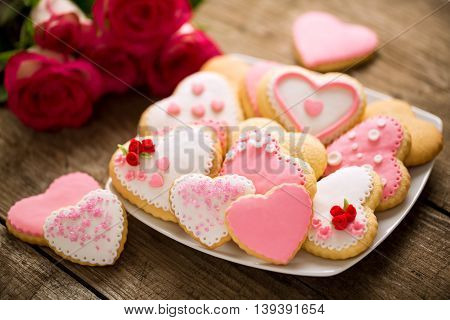 Cookies hearts on old wood background, holiday concept