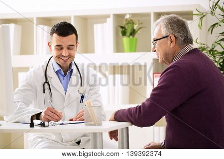 Specialist Doctor And Patient Smiling And Talking
