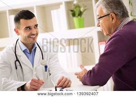Smiling Success Doctor Listening Carefully His Senior Patient
