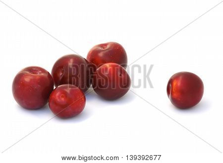 The Few plums on a white background