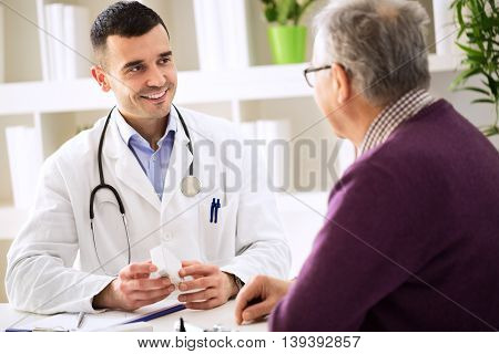 Doctor Consulting Patient With Medicine Drugs