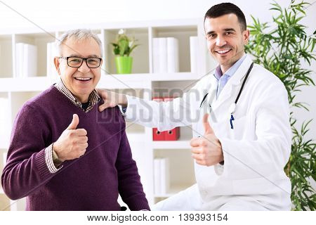 Doctor Specialist And Patient Shows Finger Up