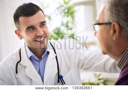 Doctor specialist and an Elderly Patient, close up