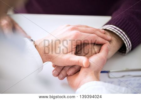 Helping The Senior Holding Hand