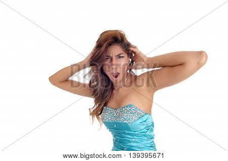 A mad young woman standing in a blue dress and brunette hair in closeup and screaming isolated for white background.