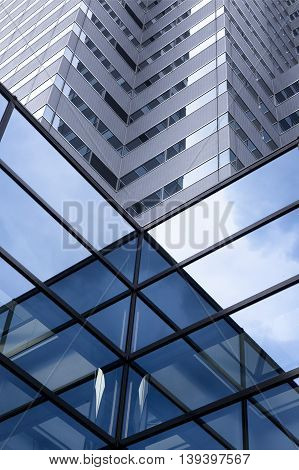 All-over glazing. Fragment of structural glass wall. Refined tilt photo of contemporary architecture in hi-tech or minimalism style.