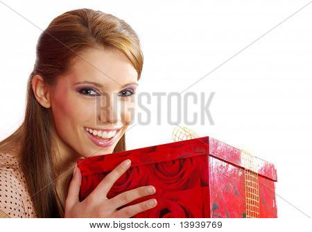 Smiling woman holding a gift box