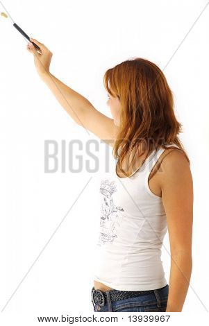 Young girl with paintbrush in hand. Painting a wall. White background,