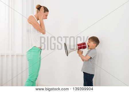 Boy Shouting At His Mother Through Megaphone
