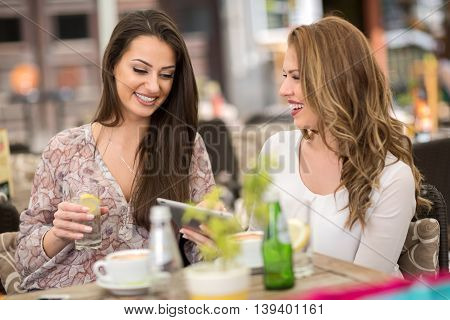 Smiling Young Women With Coffee Cups