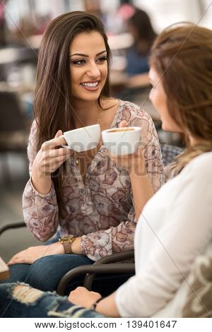 Two friends relaxing and drinking coffee Coffee break