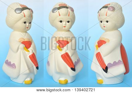 Japanese traditional doll, plaster doll, on blue background