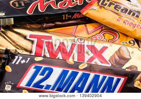Germany - June 21, 2016: different sweets. Candy heap. Snickers, Mars Twix Cream Empty calories