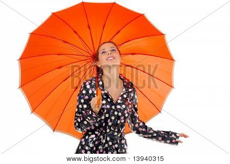 beautiful young woman with orange umbrella over white