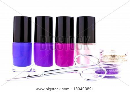 Nail care and polish, scissors, glitter isolated on white background.