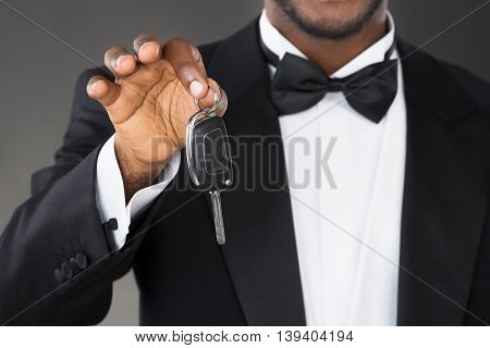Close-up Of African Waiter Holding Car Key In Hands
