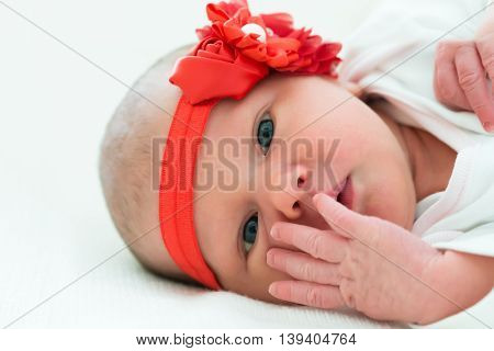 Cute Little Baby Wearing Red Flower Headband
