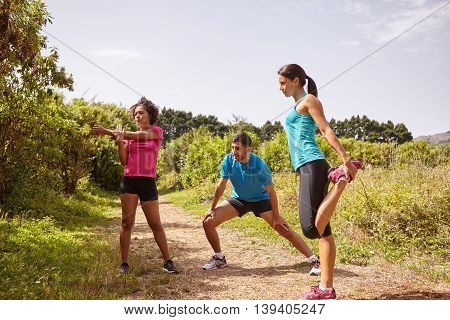 Stretching Joggers On A Running Trail