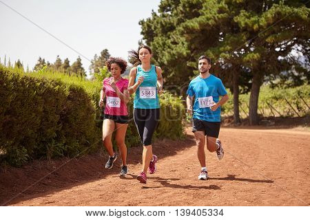 Three Friends Running A Fun Race