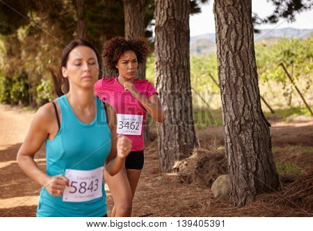 Two Girls Running A Country Race