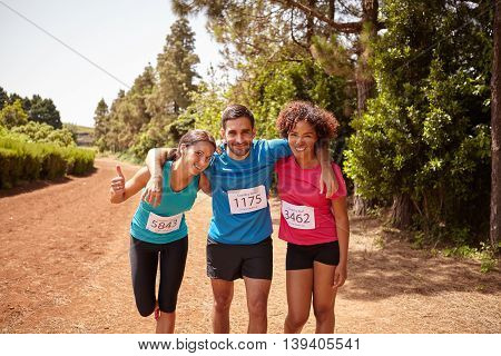 Three Runners Celebrating The Race End