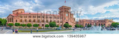 YEREVAN ARMENIA - MAY 29 2016: The red stone building with the clock tower is occupied by the Ministry of Transport and Armenian Government on May 29 in Yerevan.