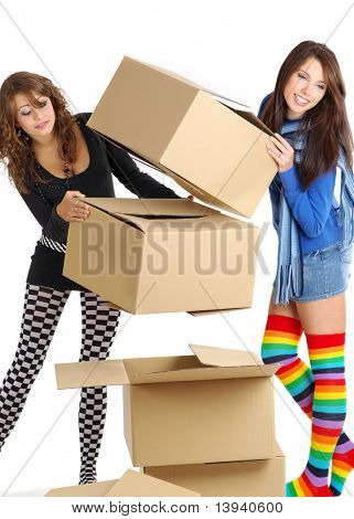 young girls packing/unpacking boxes during a relocation
