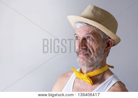 Funny senior man with a hat and bow tie arround his neck