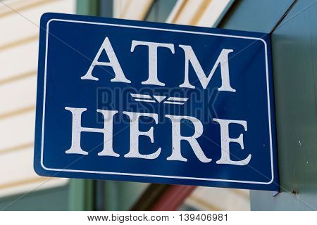 Blue and White ATM Here Wall Sign