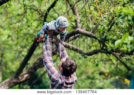 young family have fun and relaxing outdoors in the countryside