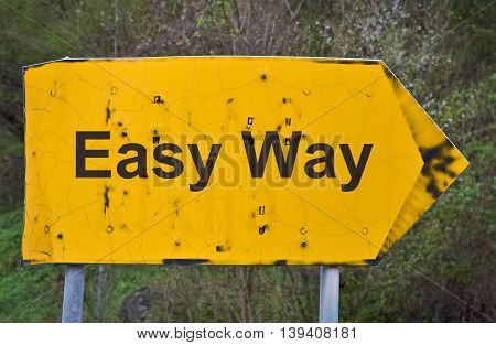 Text Easy Way written on a yellow road sign