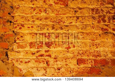 Texture of destroyed over time fragment of the castle wall, terracotta color. With place for your text