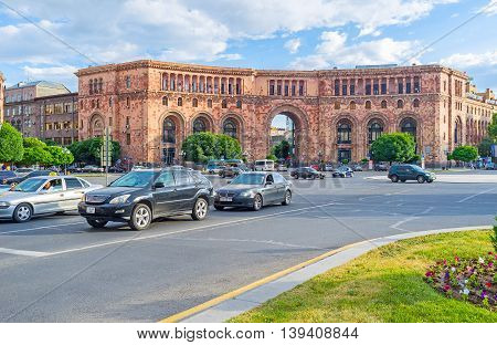 YEREVAN ARMENIA - MAY 29 2016: The monumental red stone building with the arched pass in the middle is the part of Republic Square architectural complex on May 29 in Yerevan.