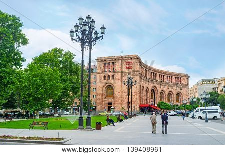 YEREVAN ARMENIA - MAY 29 2016: The complex of Republic Square consists mostly of the semicircular buildings covered with local pink tufa on May 29 in Yerevan.